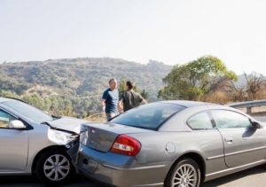 Car accident with two people outside of the cars talking
