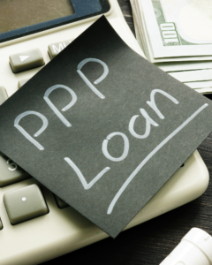 Picture of sticky note with PPP Loan written on it.